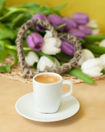 caffee: tulips on the table with cup of caffee
