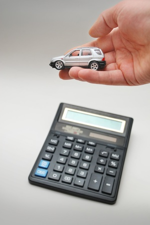Calculator and hand with toy car Stock Photo - 9103025