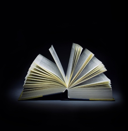 Isolated open book on black background Stock Photo