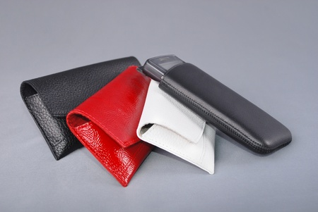Mobile phone cases on grey background Stock Photo - 9423602