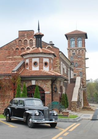 Old style retro car and castle
