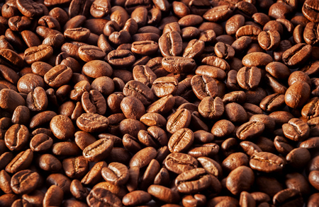 Background with many coffee beans.