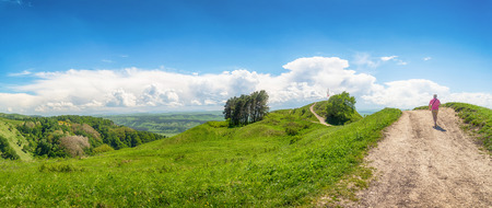 Man walking on the mountain road near the Kislovodsk, Russia. Panoramic view.