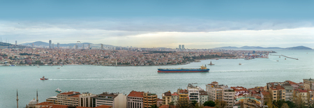Cargo ship on Bosporus in Istanbul, Turkey. Panoramic view. Istanbul, Turkey - December 7, 2019. Фото со стока
