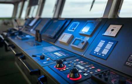 Wheelhouse control board of modern industry ship Stock Photo