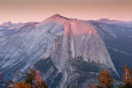 the sentinel: Half Dome from Sentinel Dome, Sunset, Yosemite National Park, CA Stock Photo