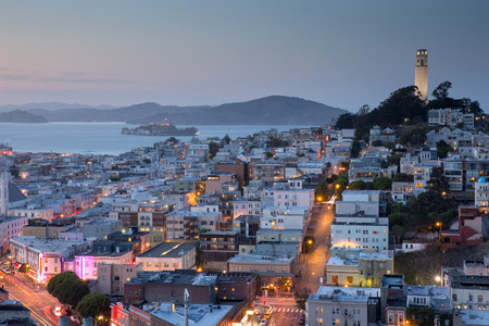 coit: Dusk over San Francisco Telegraph Hills and North Beach Stock Photo