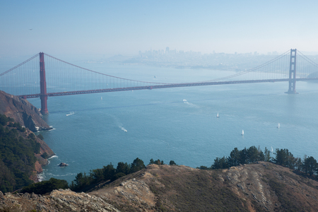 marin: Golden Gate Bridge and San Francisco Skyline in hazy day, from Hawk Hill, Marin Headlands