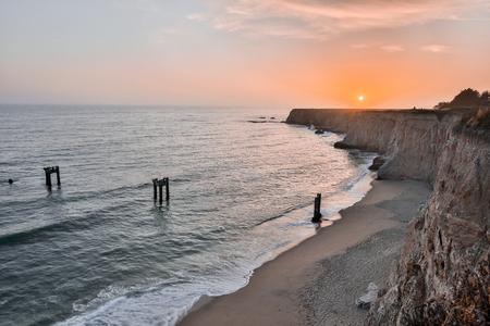 davenport: Sunset over Davenport Pier Beach