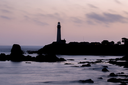 seascapes: Pink Skies and Seascapes Silhouettes of Pigeon Point Lighthouse, Pescadero, California, USA Stock Photo