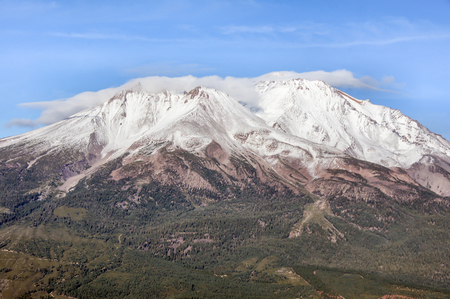 potentially: Mt. Shasta from Black Butte Trail, Siskiyou County, California, USA. Mount Shasta is a potentially active volcano at the southern end of the Cascade Range in Siskiyou County, California.