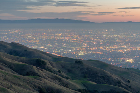 rolling hills: Silicon Valley and Rolling Hills at Dusk. Mission Peak Regional Preserve, Fremont, California, USA. West views of San Francisco South Bay and Santa Cruz Mountains with classic California rolling hills.