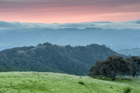 diablo: Dramatic Sunset at Mt Diablo State Park, Contra Costa County, California, USA. Scenic views of Contra Costa wilderness from BBQ Terrace Road in Mt Diablo State Park. Stock Photo