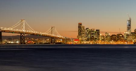 San Francisco-Oakland Bay Bridge and San Francisco Skyline, California, USA Фото со стока