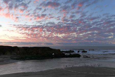 natural bridge state park: Sunset at Pescadero State Beach, San Mateo County, California, USA