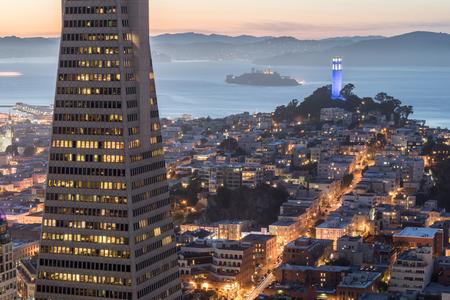 Dusk over Telegraph Hill, Alcatraz Island and San Francisco Bay from the Financial District. San Francisco, California, USA. Stock Photo