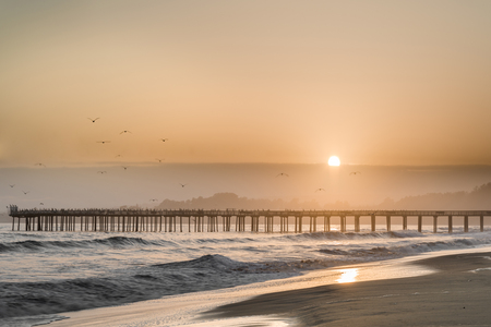 Hazy Sunset over Seacliff State Beach. Aptos, Santa Cruz County, California USA.