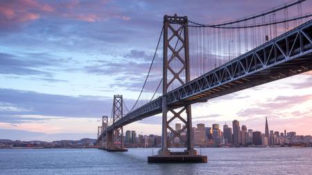 Sunset over San Francisco-Oakland Bay Bridge and San Francisco Skyline, California, USA.
