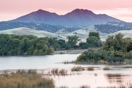 Mount Diablo Sunset from Marsh Creek Reservoir. Brentwood, Contra Costa County, California, USA. Stock Photo