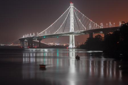 interstate 80: San Francisco-Oakland Bay Bridge Eastern Span at Night. Treasure Island, San Francisco, California, USA.