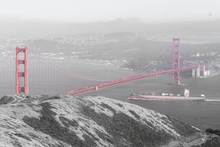 Cargo ship crossing the Golden Gate Bridge. Slackers Hill, Marin County, California, USA. Stock Photo