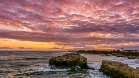 Stunning Sunset over Natural Bridges State Beach. Santa Cruz, California, USA.