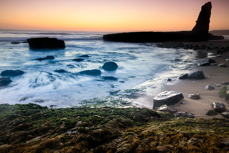Coastline Sunset Silhouette. Four Mile Beach in Wilder Ranch State Park, Santa Cruz, California, USA.