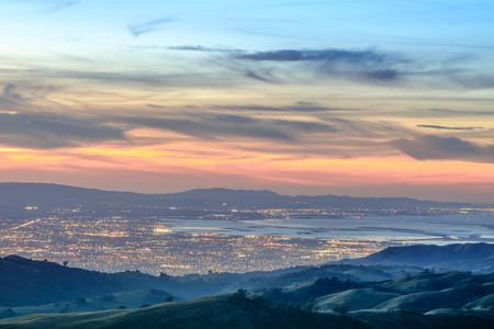 Silicon Valley Views from above. Santa Clara Valley at dusk as seen from Lick Observatory in Mount Hamilton east of San Jose, Santa Clara County, California, USA. Фото со стока
