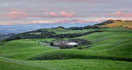 Sunset over Rolling Grassy Hills and Mount Diablo in Northern California. Views from Briones Regional Park near Martinez looking east. Contra Costa County, California, USA.