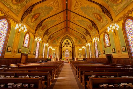 Santa Cruz, California - March 24, 2018: Interiors of Holy Cross Catholic Church. Holy Cross Catholic Church first began as one of the 21 California missions: La Exaltacion de la Santa Cruz, giving its name to the city and county. Editorial