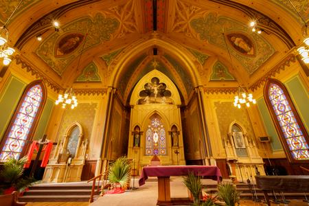 Santa Cruz, California - March 24, 2018: Altar of Holy Cross Catholic Church.  Holy Cross Catholic Church first began as one of the 21 California missions: La Exaltacion de la Santa Cruz, giving its name to the city and county.