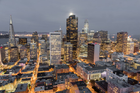 Moonshine over San Francisco Downtown. Aerial view of San Francisco Financial District as seen from a building rooftop in Nob Hill. Stock Photo