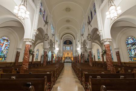 San Francisco, California - April 7, 2018: The nave of Notre Dame des Victories Church.
