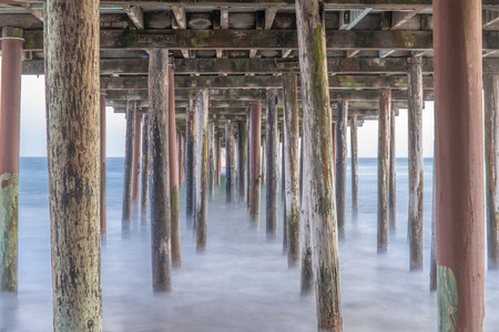 Under the Seacliff State Beach Fishing Pier. Aptos, Monterey Bay, California, USA.