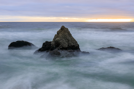 Stormy Sunset over Gray Whale Cove State Beach. Half Moon Bay, San Mateo County, California, USA.