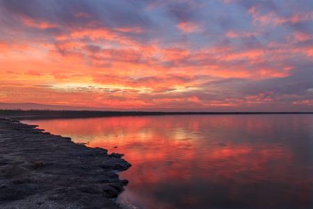 Winter Fiery Sunset in San Francisco Bay. Alviso Marina County Park, Santa Clara County, California, USA.