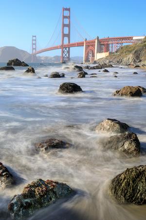 View of the Golden Gate Bridge from Rugged Marshall Beach in High Tide. Presidio, San Francisco, California, USA. Stock Photo