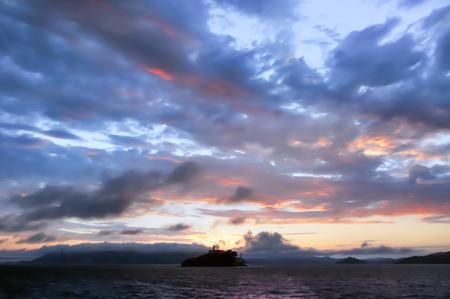 Alcatraz Island Sunset as seen from a Cruise Boat. Offshore San Francisco, California, USA.