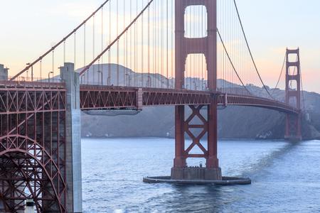 Sunset over the Golden Gate Bridge as seen from the spans southern end. The Presidio, San Francisco, California, USA.