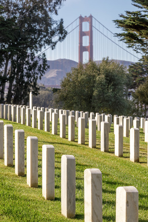 Bridge Through The Past. San Francisco National Cemetery looking north towards the Golden Gate Bridge. The Presidio, San Francisco, California, USA.
