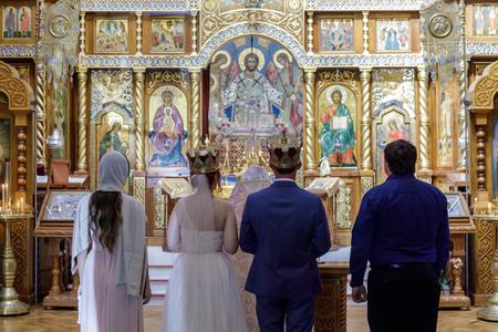Traditional Russian Wedding Ceremony in Eastern Orthodox Church. San Francisco, California, USA.