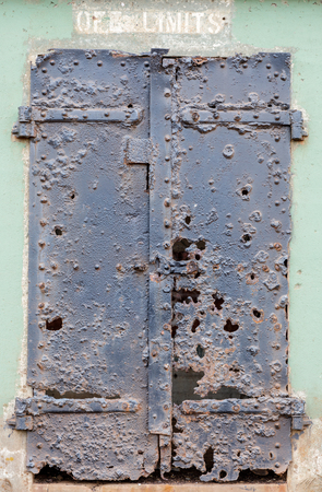 Ruins of an iron door at Battery Mendell, Fort Barry, Marin Headlands, California, USA. Battery Mendell was the first of the batteries built at Fort Barry. Construction was started in July 1901 and was completed in 1902. Stock Photo