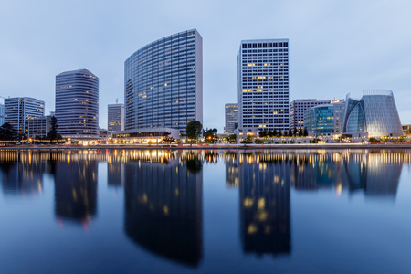 Downtown Oakland and Lake Merritt Reflections at Twilight. Oakland, Alameda County, California, USA.