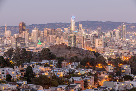 Dusk over San Francisco Downtown with Columbus Day Lights, shot from Tank Hill, Cole Valley - Twin Peaks.