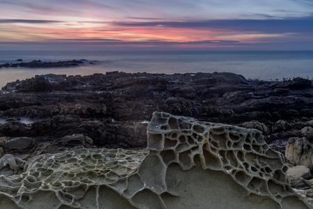 Tafoni rock formations in Bean Hollow State Beach. San Mateo County, California, USA.