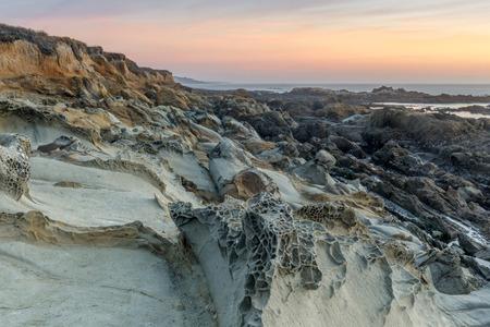 Tafoni rock landforms in Bean Hollow State Beach. San Mateo County, California, USA.