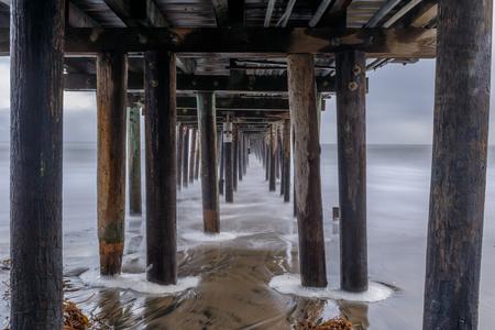 Under Capitola Wharf at Dusk. Capitola, Santa Cruz County, California, USA. Stock Photo