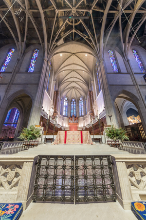San Francisco, California - December 1, 2018: Interior of Grace Cathedral Nave. The Nave is the main central area of Grace Cathedral. With 90-foot ceilings, sweeping archways, and 26 stained glass windows, it is a rare and stunning space. With a large sea