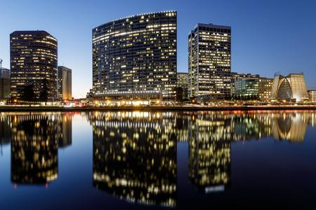 Downtown Oakland and Lake Merritt Reflections at Twilight. Oakland, Alameda County, California, USA.