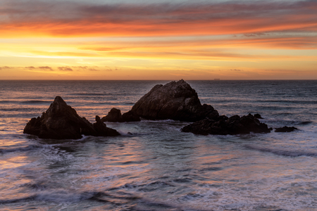 Seal Rocks Islands Winter Sunset. Uninhabited islands in the Pacific Ocean, as seen from Outer Richmond, San Francisco, California, USA.